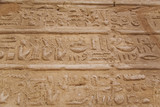 Close up of hieroglyphs cutted in walls of ancient Karnak Temple in Luxor, Egypt. Photo shot in 2017. Horizontal color photography.