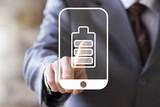 Businessman pressing button battery energy saving on smartphone