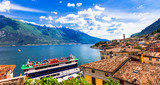 Amazing scenery of Lado di Garda, cruise boat in Limine town. Italy