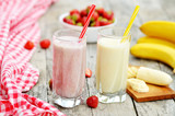 Strawberry and banana milkshake smoothie in the glass with straw
