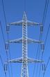 High voltage transmission lines on blue sky backdrop