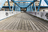 Blue iron bridge on a wooden floor