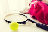 close up of tennis stuff and female sports bag