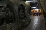 Buddha statues carved into a rock and altar inside the Xiangdong Fairy Cave in Keelung, Taiwan.