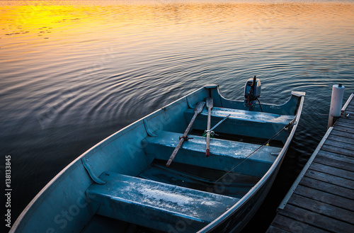 Fishing boat on tranquil lake at sunset in Minnesota