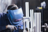 Unrecognizable worker welding with metal detail - 138161677