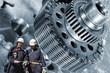 engineers, mechanics with large gears and steel machinery