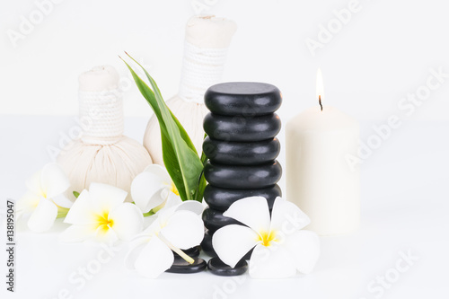 Traditional herbal spa with hot stones and herbal compress balls