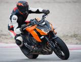 rider on a speed bike - 138197611