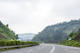 Highway road and karst mountains around in Guangxi Zhuang Autonomous Region, China