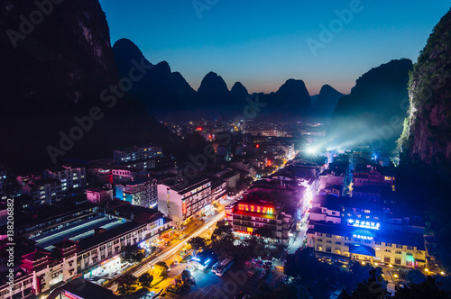 Fotobehang Guilin Yangshuo night cityscape skyline with Karst mountains in Guangxi Province, China