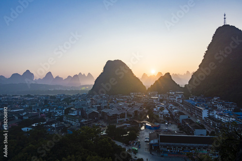 Plexiglas Guilin Yangshuo sunset cityscape skyline with Karst mountains in Guangxi Province, China