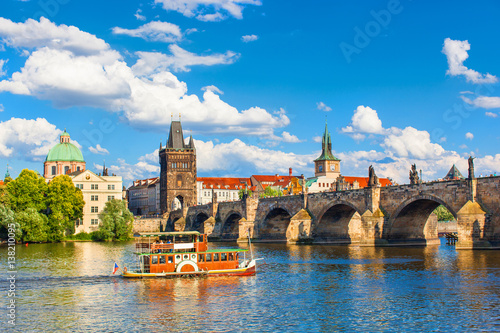 Poster Prague, Czech Republic, Charles Bridge across Vltava river on which the ship sai
