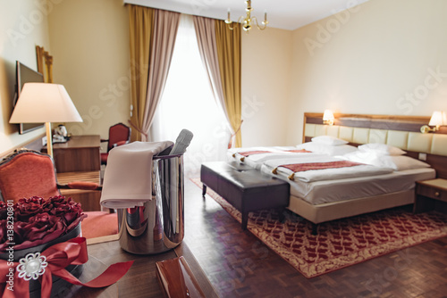 Elegant hotel room with romantic decoration and champagne. Romantic weekend concept.