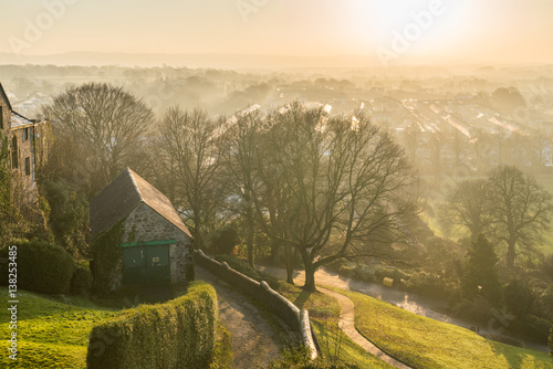 Foggy sunset view from Clitheroe Castle into the valley.