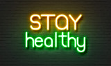Stay healthy neon sign on brick wall background. - 138287829