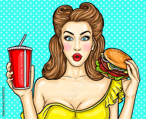Sexy pop art girl holding a cocktail in her hand