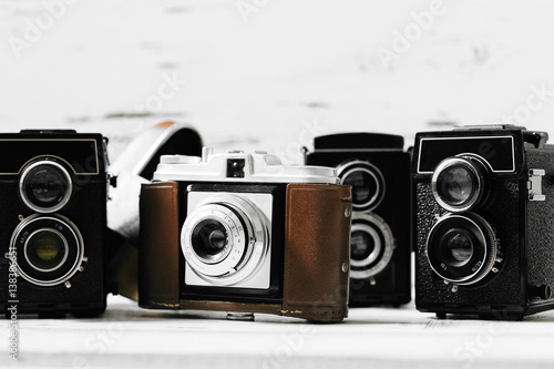 Stampa su Tela collection old vintage retro photo cameras on white wooden background