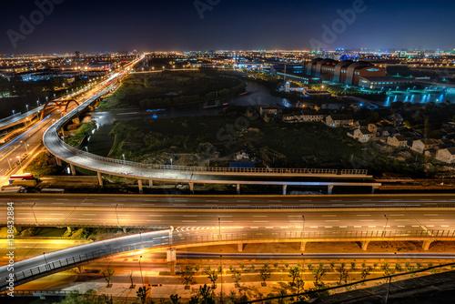 Foto op Aluminium Nacht snelweg urban traffic road with cityscape in modern city of China.
