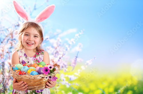 Fotografiet Easter - Little Girl With Basket Eggs And Bunny Ears