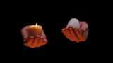 candle fire and ice in balancing hands on black background - philosophical abstract video