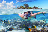 Young woman at snorkeling in the tropical water - 138498684