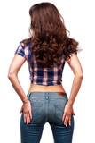 Back view of young female in shirt and jeans, isolated on white