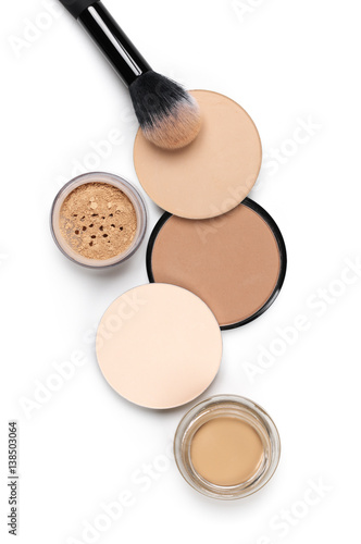 Set of various face powder and brush