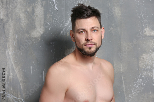 Aluminium Handsome young man posing on color background