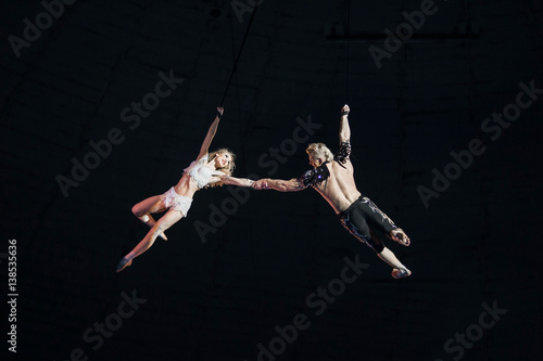 Stunt aerialists in the circus. Love, danger, and romance concept.