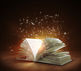 Open Magic Book with magic light and flying letters. 3d rendering - 138540011