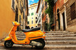 Quadro Orange vintage scooter on the background of Rome street