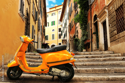 Orange vintage scooter on the background of Rome street Poster