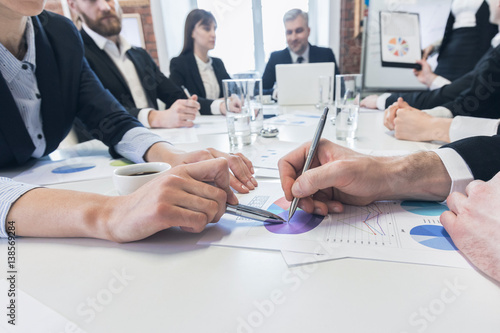 Business people pointing at diagram