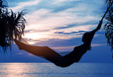 Photo of relaxed woman resting and looking at the sunrise