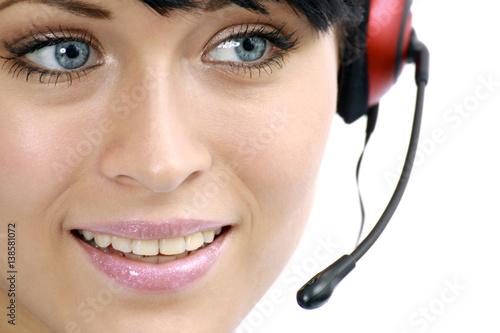Leinwanddruck Bild Junge Frau mit Headset in einem Callcenter