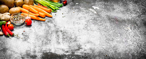 Fresh vegetables . Fresh vegetables with spices and herbs. On rustic background.