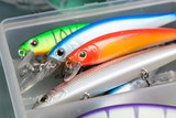 Closeup of a fishing box with colorful lures. - 138596426