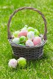 Easter eggs basket on grass
