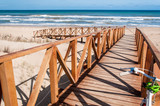 A wooden walkway  leading to beach