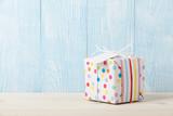 Polka dot gift box on wooden table