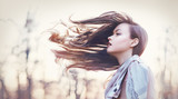 her hair tooked by the wind