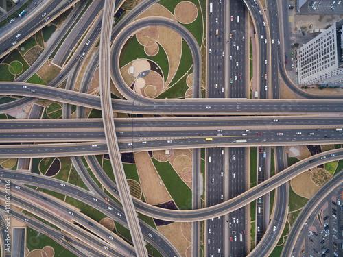 Plakat aerial view of road junction with railway tracks in Dubai, UAE