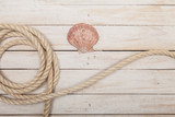 Rope and sea shell on wooden background - 138639693