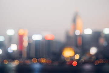 Blurred abstract background of cityscape at sea harbour hong kong at night time,urban life,vintage filter
