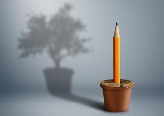 Idea birth, creative concept, pencil growing from pot © dimj