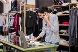 Entrepreneur talking at phone in shop - 138661265