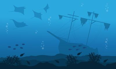 Silhouette of big ship stingray underwater landscape
