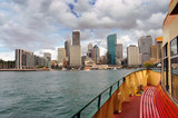 View of Sydney financial district as seen from boat sailing Sydney Harbour
