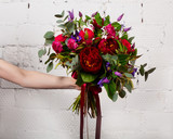 Creative bouquet of flowers at arm's length, beautiful flowers as a gift beloved. - 138681448
